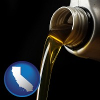 california pouring motor oil, on a black background