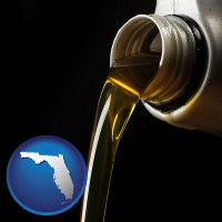 florida pouring motor oil, on a black background