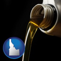 idaho pouring motor oil, on a black background