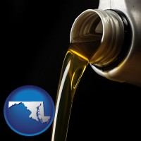 maryland pouring motor oil, on a black background