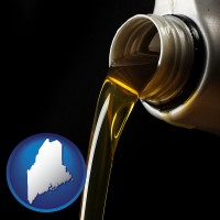maine pouring motor oil, on a black background