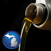 michigan pouring motor oil, on a black background
