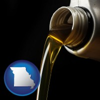 missouri pouring motor oil, on a black background