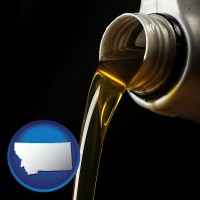 montana pouring motor oil, on a black background