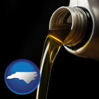north-carolina pouring motor oil, on a black background