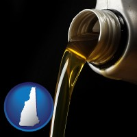 new-hampshire pouring motor oil, on a black background