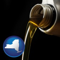 new-york pouring motor oil, on a black background