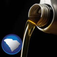 south-carolina pouring motor oil, on a black background