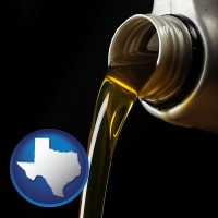 texas pouring motor oil, on a black background