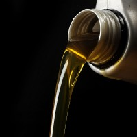 pouring motor oil, on a black background
